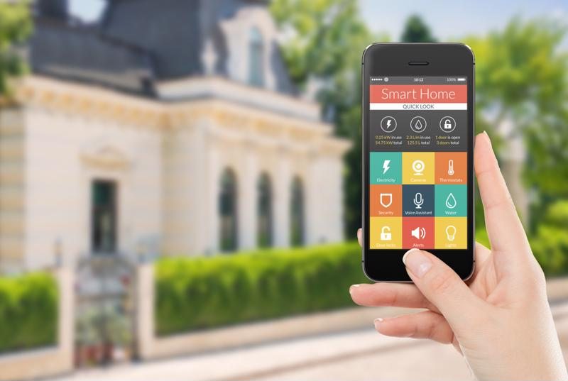 Smart phone app in front of house.