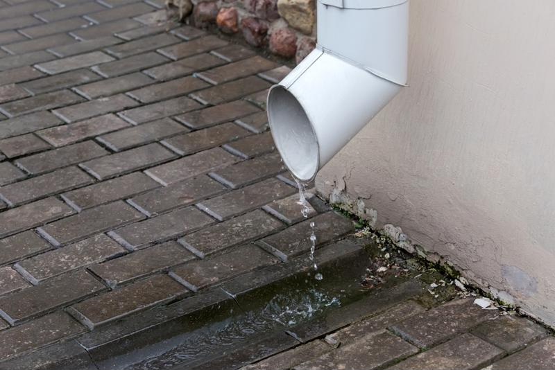 The drain spout should direct water several feet away from the foundation.