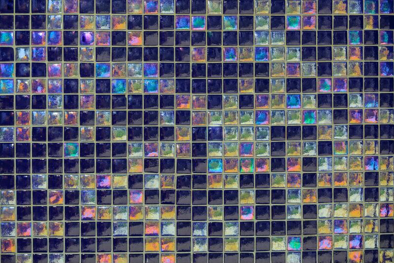 Consider using glass tiles to create a floor mosaic.