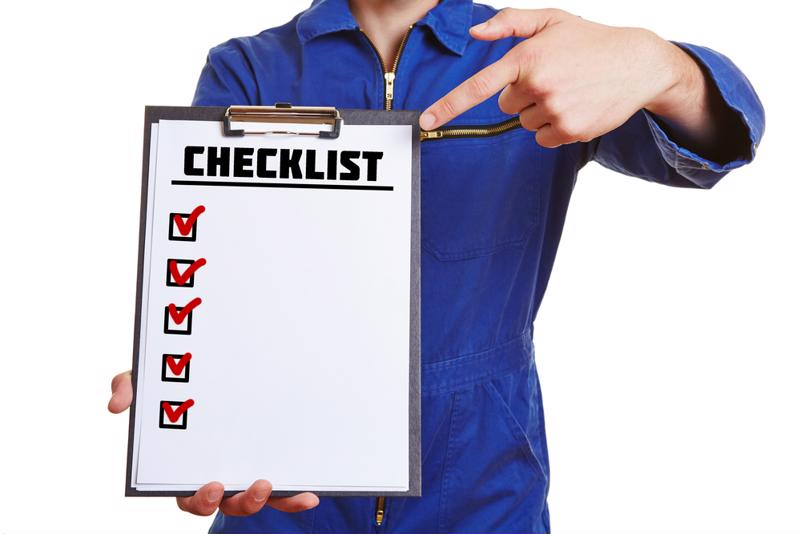 A person holding a clipboard with a checklist on it.