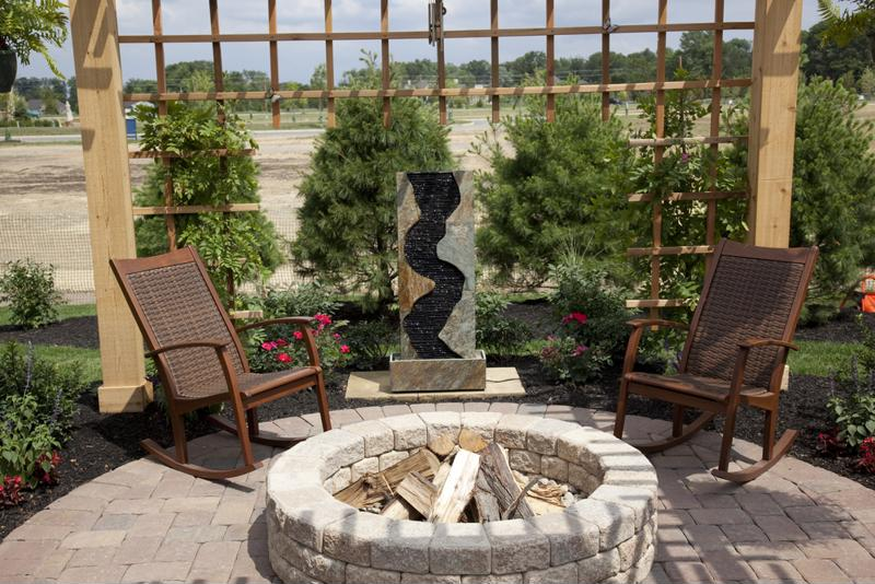 Concrete pavers can serve as a great accompaniment to any backyard firepit.