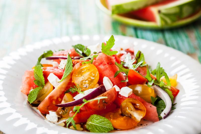 Watermelon and tomato salad is a perfect way to combine fresh fruits and veggies.