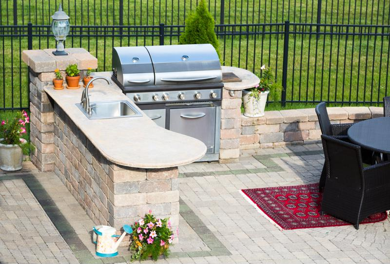 Grill on paver custom patio.