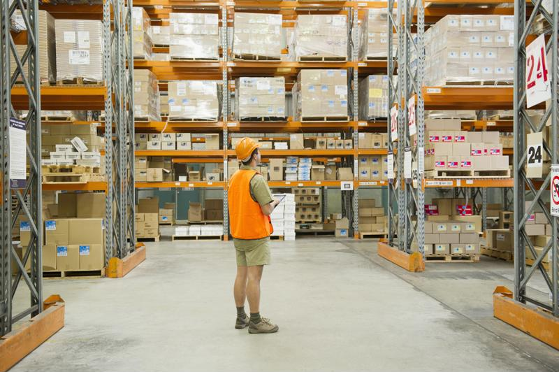 warehouse employee looking over inventory