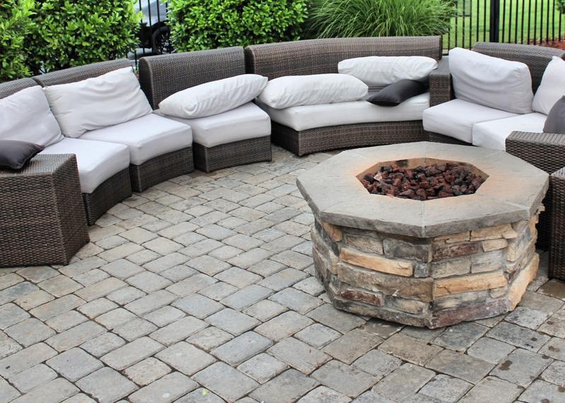 Stone fire pit on custom patio.