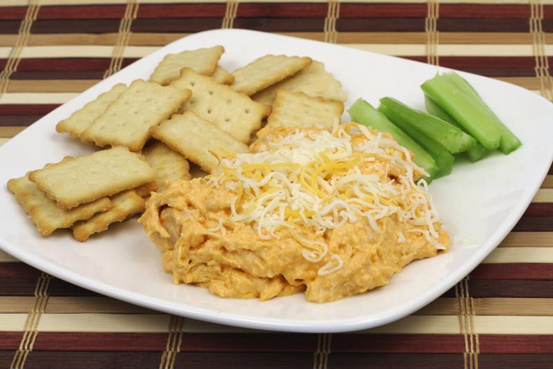 Pulled chicken cheese dip is perfect for dipping crackers, veggies, nachos and more.