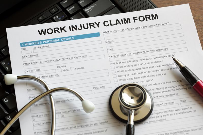 Injury claim form on desk with stethoscope on top.