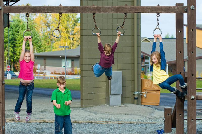 Kids playing on a playground.