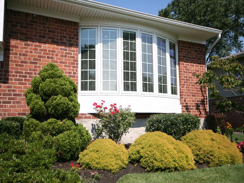 Bay windows expand outside of the home's exterior.