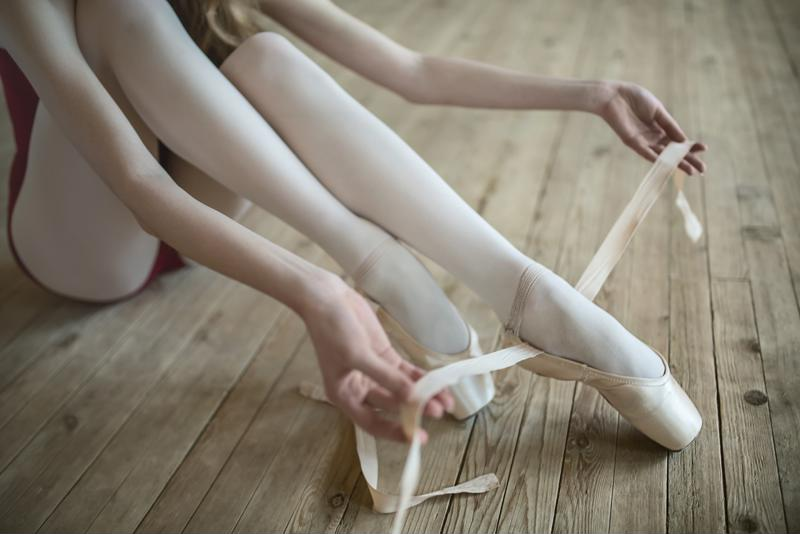 You'll learn the basics of tying pointe shoes in your first class.
