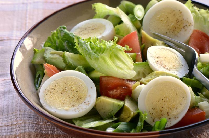 Hard boiled eggs can add a helpful shot of protein to your salad.