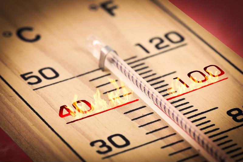 Close-up of thermometer with flame effects around the 40 Celsius and 100 Fahrenheit threshold