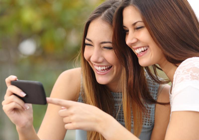 Girls socializing while using social media.