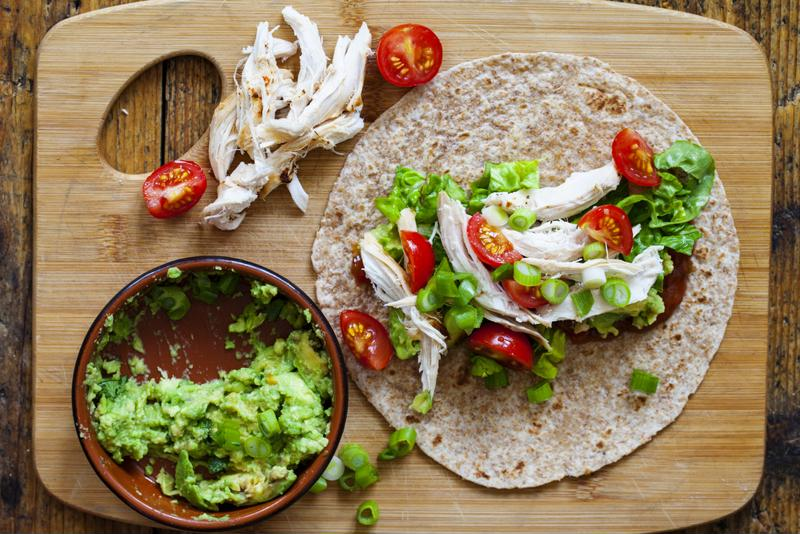Turkey wraps with mashed avocado can be made on tortillas or lettuce wraps.