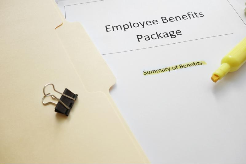 Employee Benefits Package paper stack next to a manila folder.