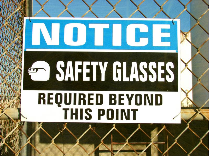 "Sign reading ""Notice: Safety glasses required beyond this point."""