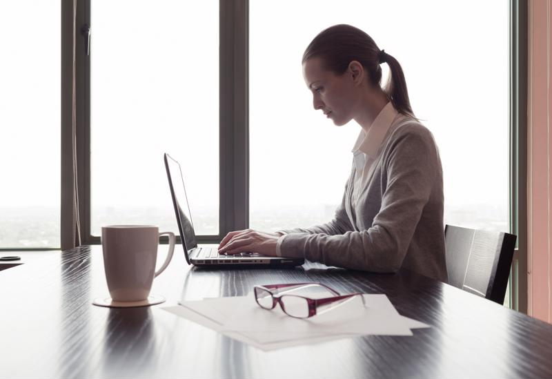 Woman using computer in office.