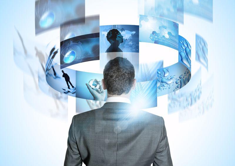 Business leader looks at several digital feeds