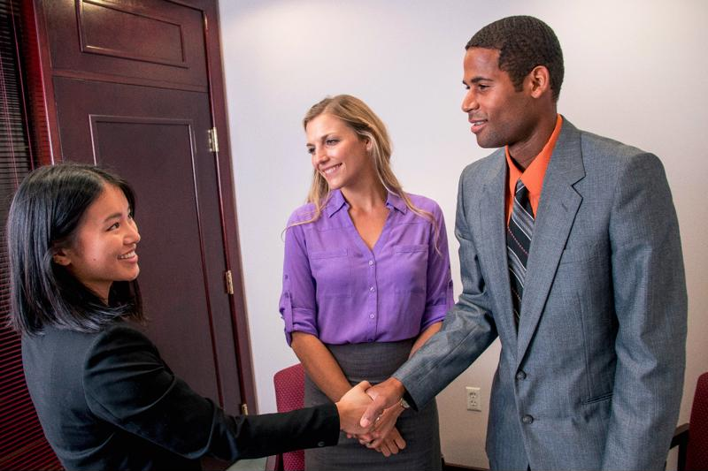 A warm greeting and inviting smile are critical in an interview setting.