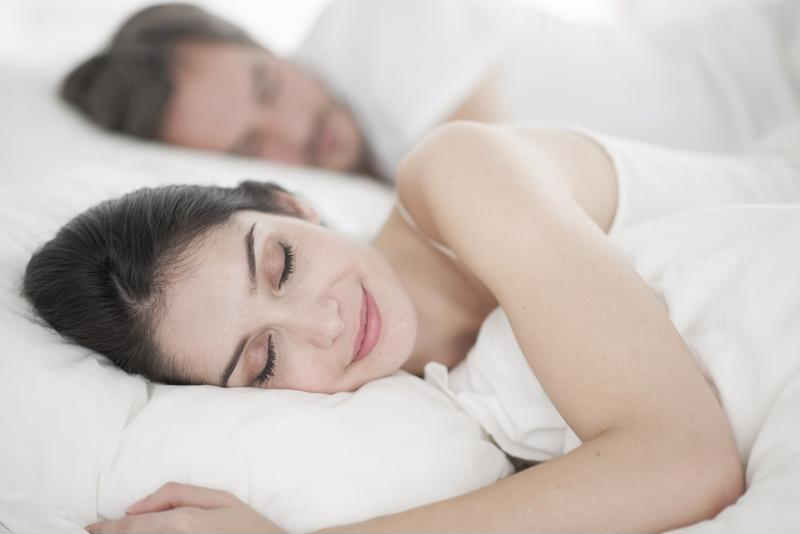 It's easy for two people to sleep comfortably in bed with heated mattress pads that have dual controls.