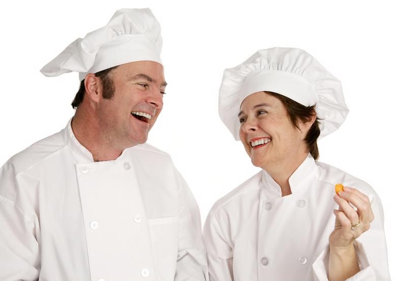 Two chefs smiling at each other
