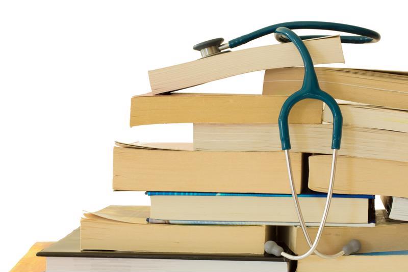 Stethoscope on top of school books.