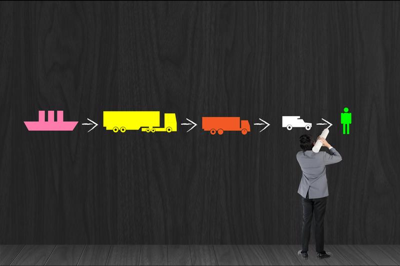 Colored silhouettes of various forms of freight connected by arrows to illustrate a supply chain.