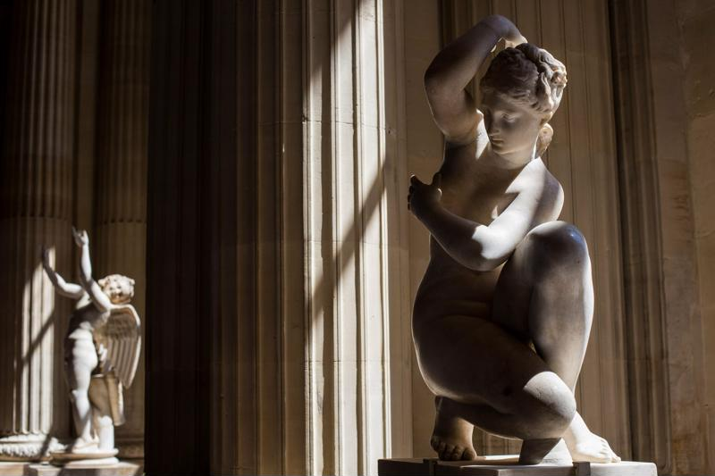 Classical sculptures in a museum.