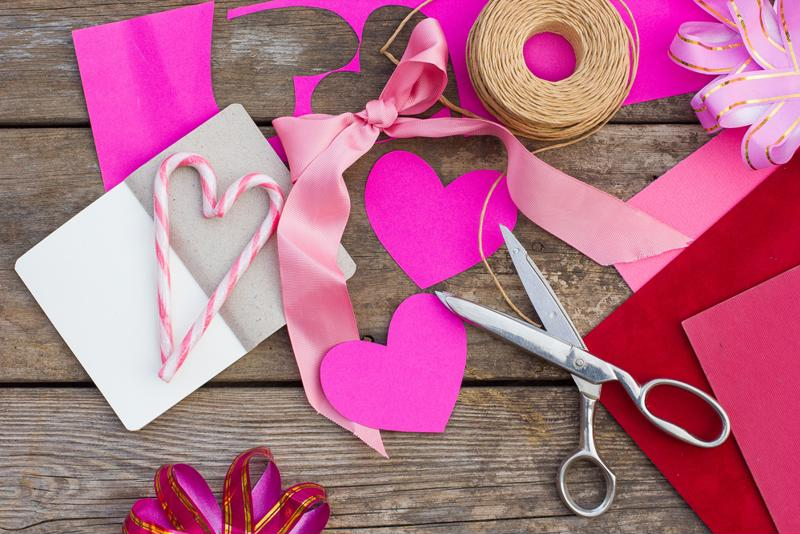 Paper hearts, scissors, twine, ribbon and candy canes