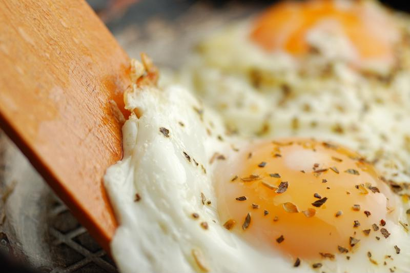 Adding a savory, basted egg to your morning oats will add both protein and flavor.