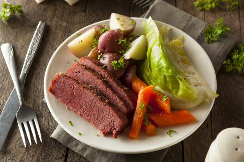 Serve corned beef and cabbage with carrots and potatoes.