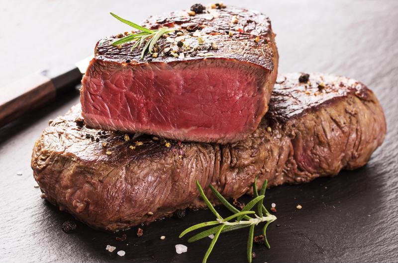 Steak cut in half against the grain.