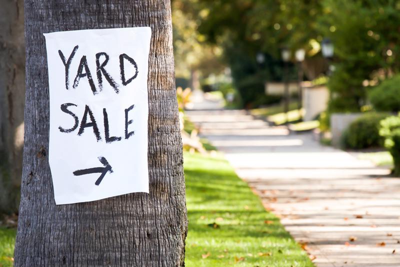 Save money by organizing a community yard sale.