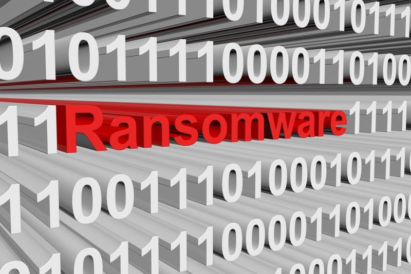 """Ransomware"" in red among white and grey zeros and ones."