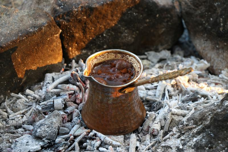 Throughout history, people would brew coffee over hot coals.