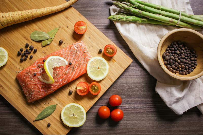 Season your salmon with the desired about of spices before slow cooking.