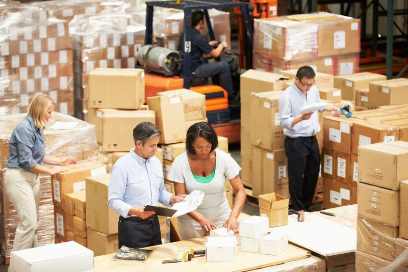 Warehouse workers fulfill orders.