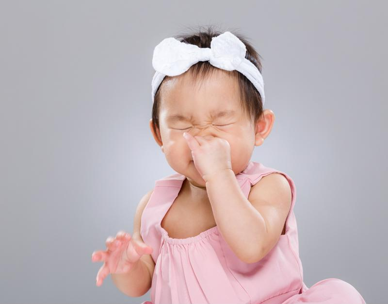 A little baby sneezing.