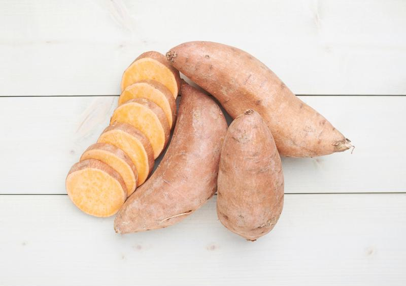 Candied and topped with bacon, sweet potato rounds are a delicious side dish.