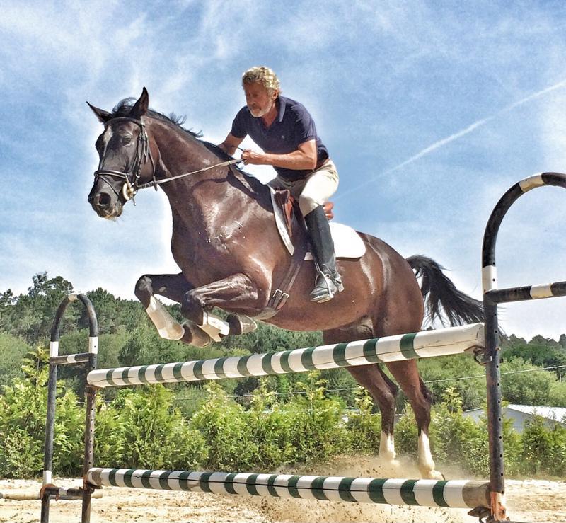 man jumping horse