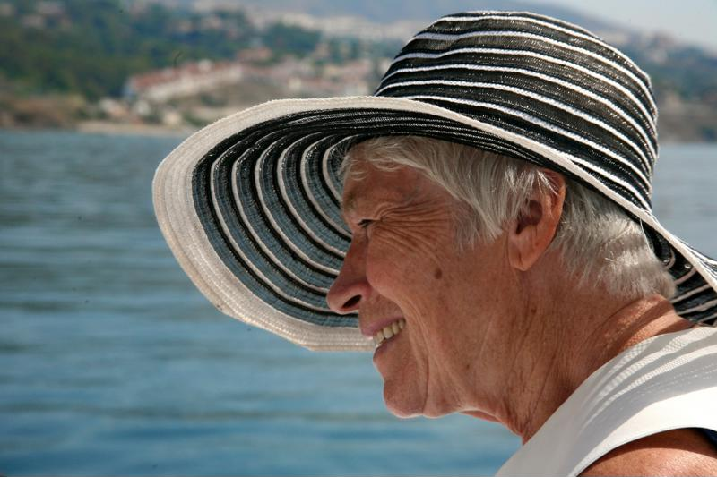 Senior woman wearing sun hat.