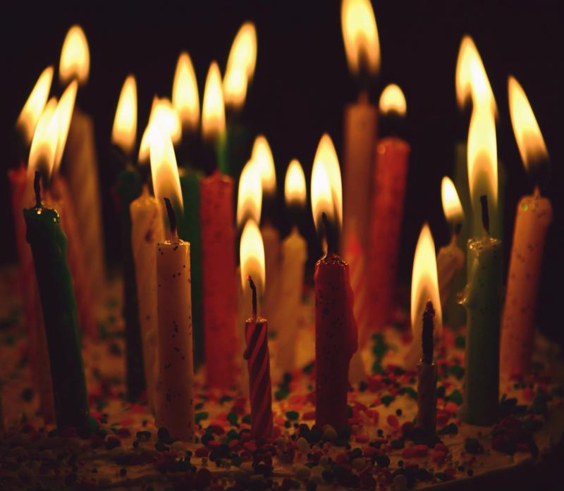 Donned with lit candles, birthday cakes are the star of the celebration.