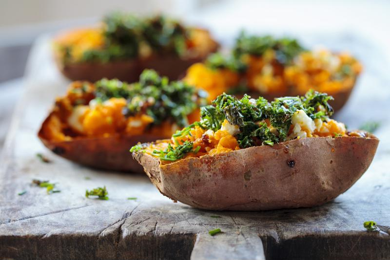 Swap regular potatoes with sweet potatoes and top with kale for this tasty recipe.