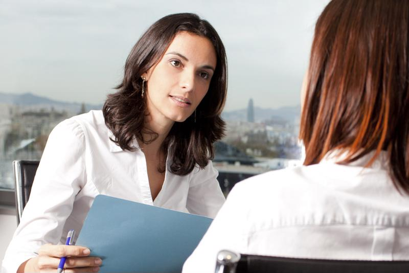 management consultant working with businesswoman