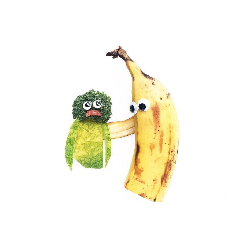 Banana and broccoli with eyes.