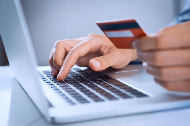 Man using a credit card to shop online