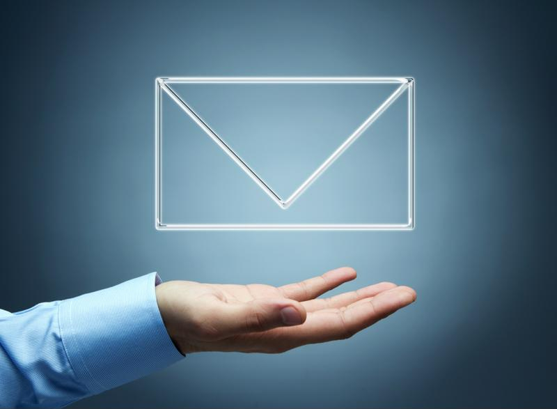 Outstretch hand with email envelope icon above it.