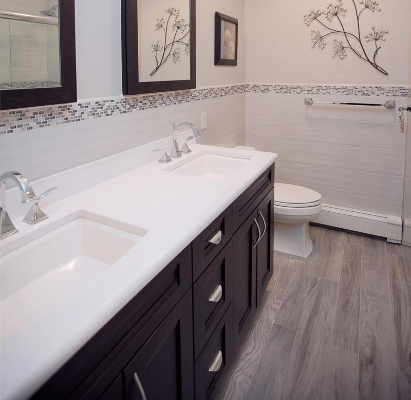 Updating the bathroom vanity and sink can make the room more convenient.
