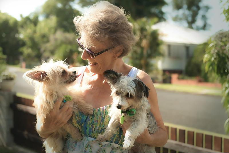 Senior woman with dogs.