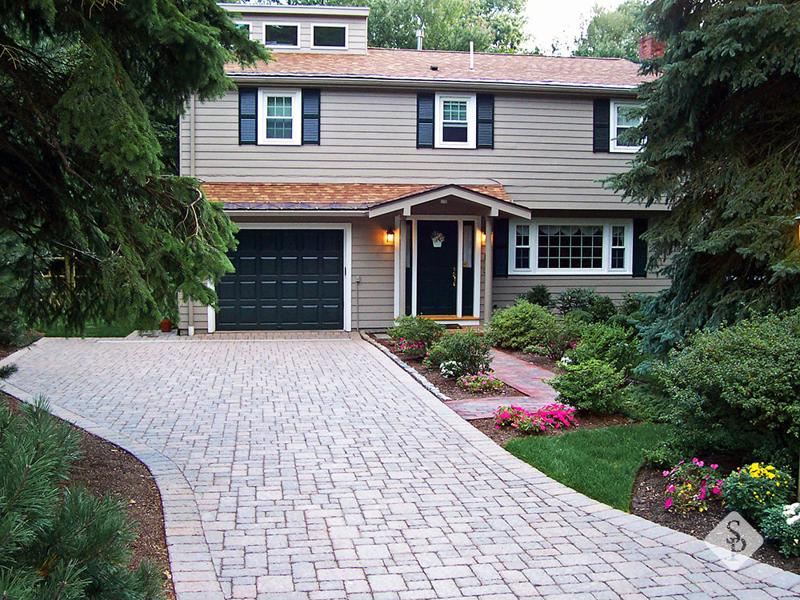 System Pavers house with stone paver driveway.